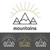 山与日出的阵营商标在小山后 免版税库存图片