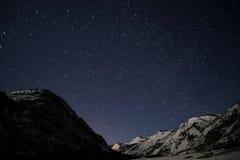 山星跟踪天空雪 库存照片