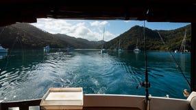 山景消遣渔船后面  库存图片