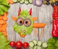 山羊由菜成份制成在桌 库存图片