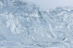 山背景,美丽的冬天冰,蓝色纹理 库存照片