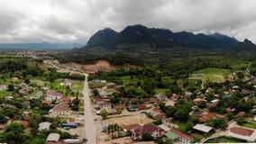山脉与小镇重叠 免版税图库摄影
