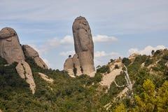 山西班牙 中央山非常类似于柱子 有山的登山人 免版税库存图片