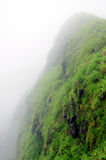 山顶层和云彩 免版税库存照片