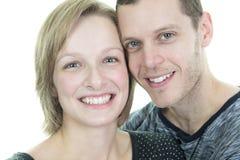 30岁在演播室白色的夫妇 免版税库存图片