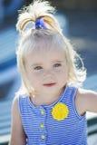 2岁画象在蓝色背景哄骗 库存图片