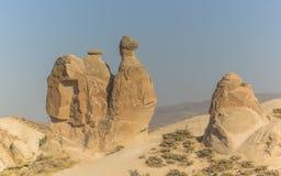 岩石在卡帕多细亚,骆驼 库存照片