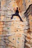 岩石墙壁妇女 免版税库存照片