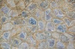 岩石墙壁无缝的背景纹理 免版税库存照片