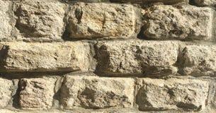 岩石墙壁,石墙纹理背景 免版税库存照片