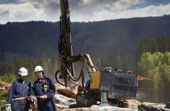 岩石炸开的工程学和钻机械 免版税库存图片
