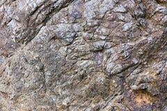 岩石纹理和表面背景 崩裂的和被风化的natur 免版税库存图片