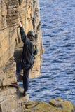 峭壁登山人 库存照片