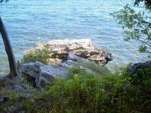 峭壁的边缘在洞点的在密执安湖 免版税图库摄影