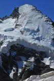 峭壁d凹痕表面北部herens的冰 库存图片