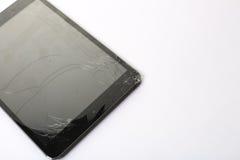 崩裂的和损坏的片剂屏幕 免版税库存图片