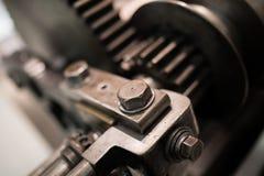嵌齿轮和螺栓 图库摄影