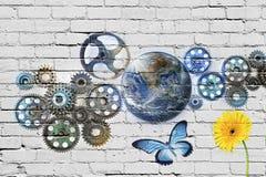 嵌齿轮地球街道画墙壁 免版税图库摄影