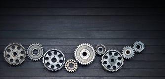 黑嵌齿轮技术产业背景 库存照片