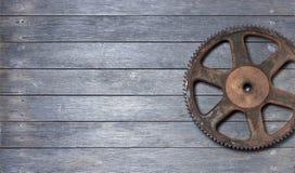 嵌齿轮木头背景 库存图片