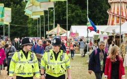 巡逻在Womad节日的警察 免版税库存照片