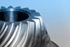 工业圆锥形齿轮,钝齿轮 蓝色被定调子的图象 免版税图库摄影