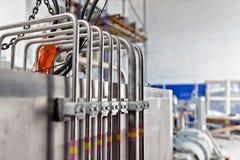 工业应用的小直径不锈钢管 免版税库存照片