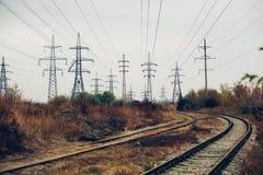 工业有雾的风景-老被放弃的工业区在秋天森林里 免版税库存照片