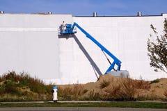 工业画家和起重机 免版税图库摄影