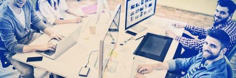 工作在创造性的办公室的专家画象  免版税图库摄影