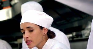 工作在厨台的厨师队  影视素材