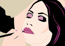 工作在年轻和美女的化妆师 库存例证