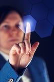 工作在未来派网际空间hightech environm的女实业家 免版税图库摄影