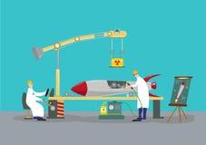 工作在火箭导弹弹头的科学家 反向工程概念 图库摄影