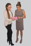 工作在片剂的两个女商人 免版税图库摄影