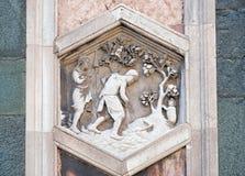 工作在秋天以后的亚当和伊芙,佛罗伦萨大教堂 图库摄影