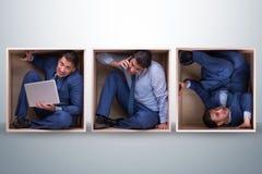 工作在紧的空间的雇员 免版税库存图片