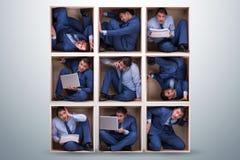 工作在紧的空间的雇员 免版税库存照片