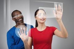 工作在触摸屏上的少妇 免版税库存图片