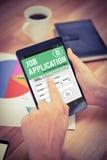 工作申请书的综合图象在智能手机的 免版税库存图片