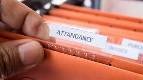 工作的人的出席人数名单记录时间 免版税库存图片
