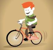 公司人骑他的自行车 图库摄影