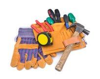 工具传送带和防护手套 图库摄影