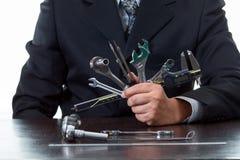工具和机械工程师工作在举行许多种类旁边凿出的装饰 库存照片
