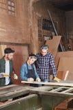 工匠和妇女作为学徒 免版税库存图片