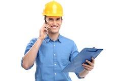 工程师佩带的安全帽 库存图片