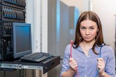 年轻工程师和女实业家有管理控制台的 免版税库存照片