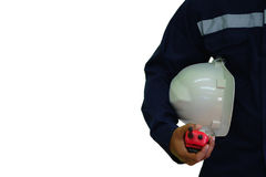 工程师拿着通信收音机和白色安全盔甲的 免版税图库摄影