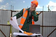 工程师盔甲夹克橙色radi谈话 库存照片