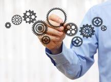 工程师画链扣练齿轮 技术和产业concep 免版税图库摄影